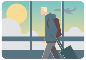 Um homem andando com seu vetor de bagagem