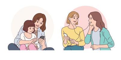 mãe e filha estão olhando para telefones celulares. amigos que ouvem música em seus telefones celulares. vetor
