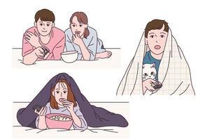 pessoas que usam cobertores e assistem tv. vetor