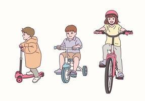 crianças fofas andando de bicicleta. vetor
