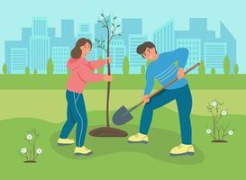 um jovem e uma mulher plantando uma árvore no parque
