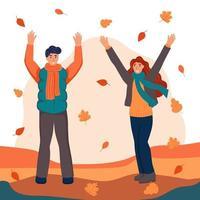 um casal de amantes caminhando e jogando folhas caídas no parque. o conceito de namoro outono