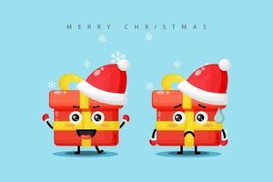 uma caixa de presente fofa mascote vestindo uma fantasia de natal com uma expressão feliz e triste vetor