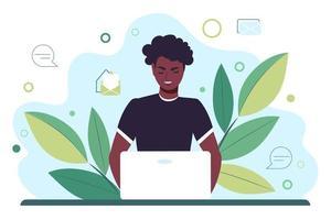 jovem afro-americano trabalha atrás de um monitor de laptop. ensino à distância online ou trabalho remoto. ilustração vetorial plana vetor