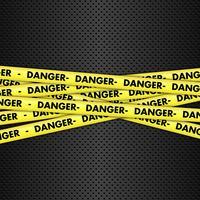 Fita de perigo no fundo metálico vetor
