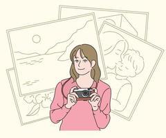 uma garota está segurando uma câmera e tirando fotos. mão desenhada estilo ilustrações vetoriais. vetor