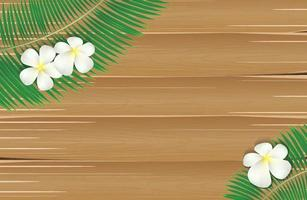 folha de coqueiro com flor de plumeria na tábua de madeira vetor