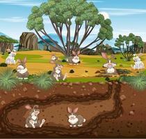Toca de animais subterrânea com família de coelhos vetor
