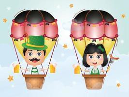 casal fofo em balão de ar quente com vestido tradicional da oktoberfest vetor