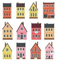 conjunto de pequenas fachadas de casas vetor