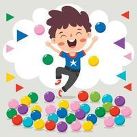 garoto engraçado brincando com bolas coloridas vetor
