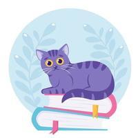 gato fofo deitado na pilha de livros dia mundial do livro vetor