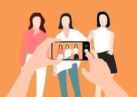 as mãos de um homem tirando fotos de um grupo de mulheres com um smartphone e mostrando a foto na tela vetor