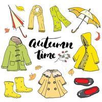 conjunto de roupas de outono. mão desenhada rabiscos e letras de ilustração vetorial. vetor