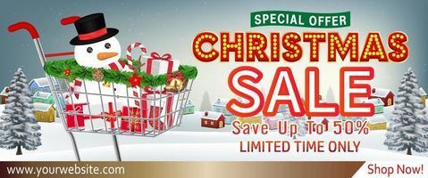banner de venda de natal com caixa de presente no carrinho vetor