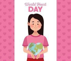 letras do dia mundial do coração com uma mulher levantando uma terra em forma de coração vetor