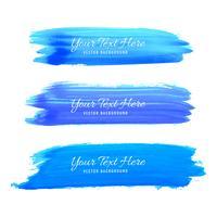 Conjunto de design de traçados de pincel aquarela azul vetor