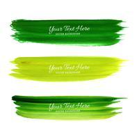 Conjunto de design de traçados de pincel aquarela verde vetor