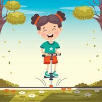 garoto engraçado brincando com pula-pula vetor