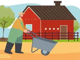 Fazenda e fazendeiro agrícola com celeiro de carrinho de mão vetor