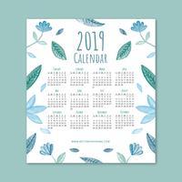 Calendário 2019 bonito com folhas e flores azuis vetor