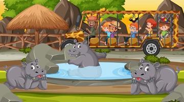 safári noturno com crianças assistindo grupo de hipopótamos vetor