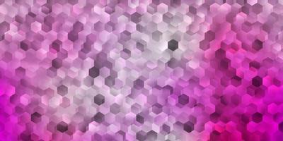 pano de fundo de vetor rosa claro com um lote de hexágonos
