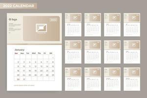 Modelo de calendário 2022 de 12 meses com moldura vetor