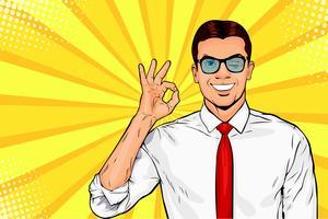 O homem de negócios pisc e mostra o gesto aprovado ou APROVADO