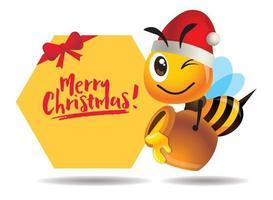 feliz Natal. Abelha fofa de desenho animado carrega um pote de mel com uma grande tabuleta de saudação de feliz natal vetor