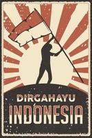 poster retro da Indonésia feliz dia da independência com o homem levantando a bandeira vetor