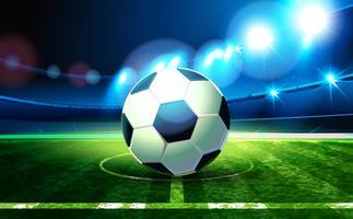 Bola de futebol e arena de futebol.