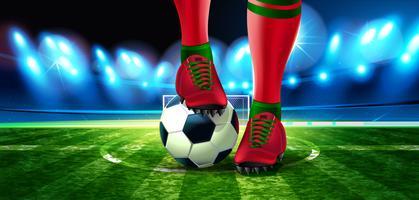Bola de futebol no estádio de futebol com uma parte do pé de um jogador de futebol