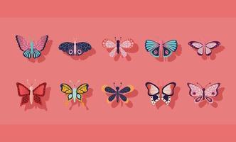 conjunto de borboletas em um fundo rosa vetor