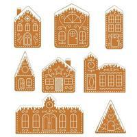 conjunto de casas isoladas de gengibre. biscoitos de natal tradicionais vetor