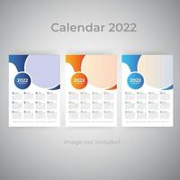 Conjunto de modelos de calendário de parede de uma página para negócios coloridos 2022 vetor
