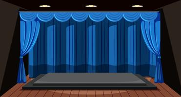 Um palco vazio com cortina azul
