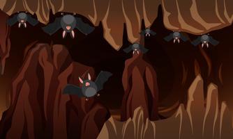 Uma caverna escura de morcegos vetor