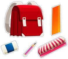Adesivo conjunto de materiais escolares vetor