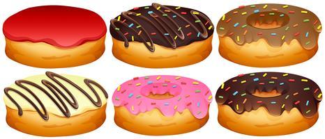 Conjunto de donuts diferentes coberturas vetor