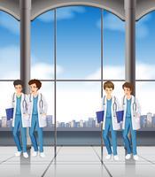 Enfermeiras do sexo masculino no hospital vetor