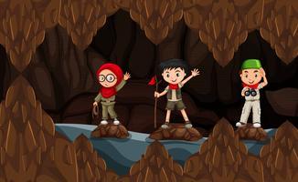 Explorador explorando a caverna escura vetor