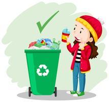 Uma garota colocar o copo na lata de lixo vetor