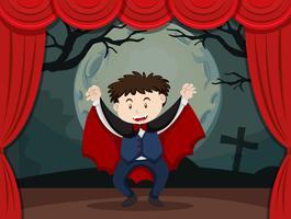 Palco jogar com menino em traje de vampiro vetor