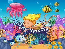 Garota nadando com animais marinhos debaixo d'água vetor