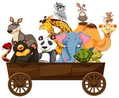 Muitos tipos de animais no vagão de madeira vetor