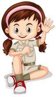 Garota feliz acenando a mão vetor