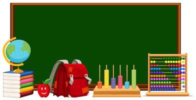 Quadro-negro e materiais escolares vetor