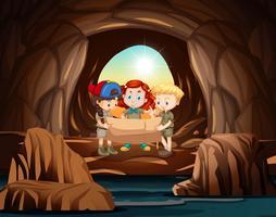 Um grupo de batedores se aventura na caverna vetor