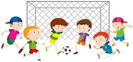 Grupo de meninos jogando futebol vetor